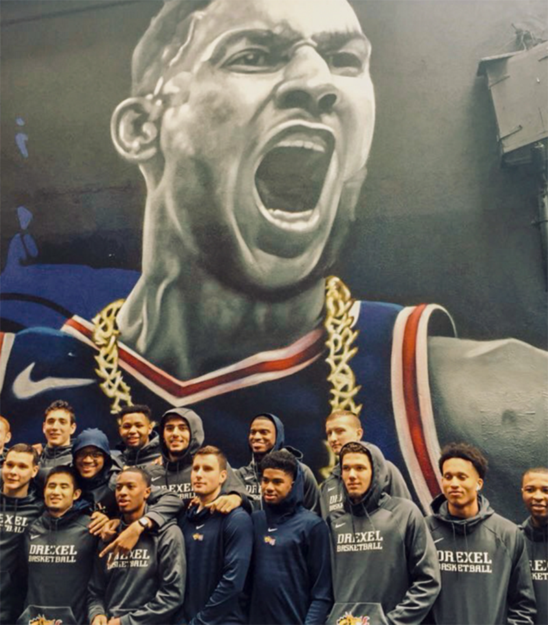 Drexel's men's basketball team in front of a mural of Ben Simmons in Melbourne, Australia.