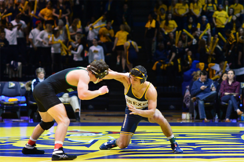 A scene from one of the men's wrestling team's matches in 2018.