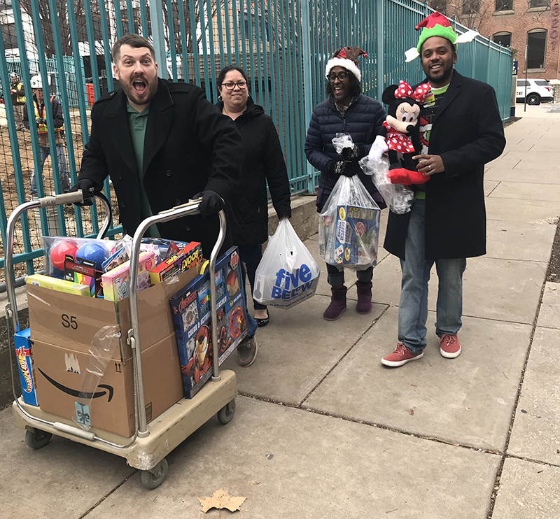 Members of the Procurement Services team participating in Drexel's annual Holiday Toy Drive.
