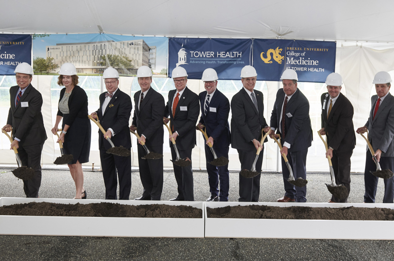 Photo of Drexel and Tower Health officials with shovels at the ceremonial groundbreaking