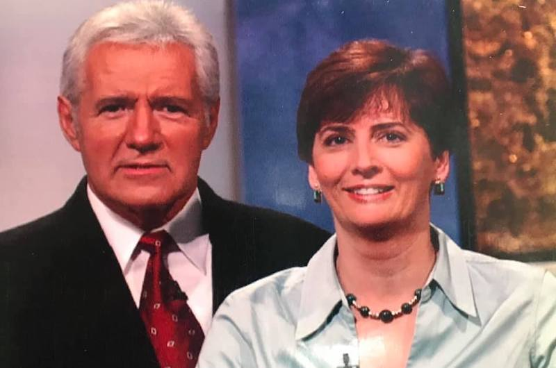 "Vice President and University Secretary Janice K. (Jake) Marini pictured with Alex Trebek while appearing on ""Jeopardy!"""