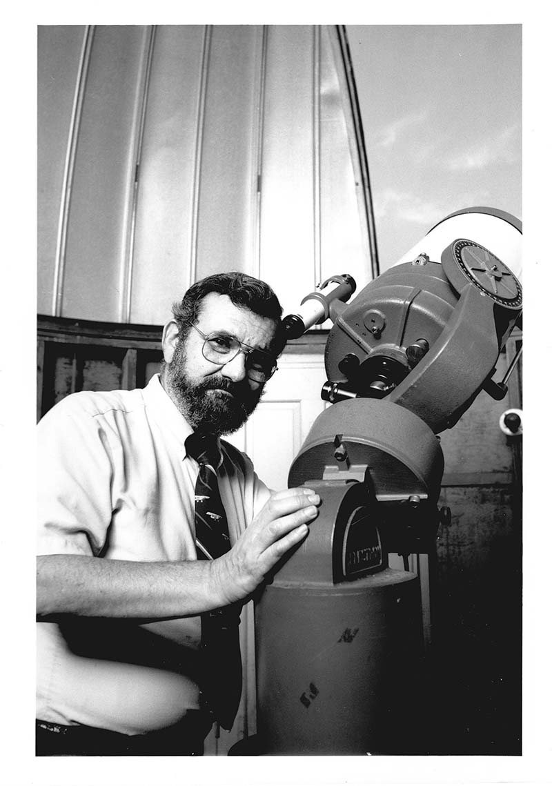 A photo from 1987  featuring Leonard R. Cohen, PhD, in front of the observatory with a telescope. Photo courtesy Drexel University Archives.