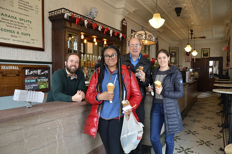 Franklin Fountain co-owner Eric Berley, left, with Drexel student Toni Hicks, assistant clinical professor Michael H. Tunick and student Nora Vaughan at the local ice cream parlor Franklin Fountain in February 2019. Vaughan and Hicks were finalists in a Drexel ice cream contest partially judged by Berley and Tunick in which the winner designed an ice cream sold at Franklin Fountain.