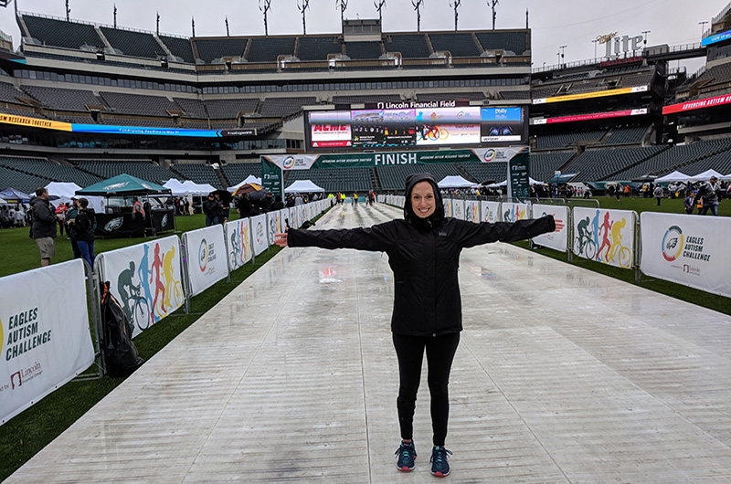 Assistant Project Director of Transition Pathways in the A.J. Drexel Autism Institute Jackie Abrams stands before the finish line inside Lincoln Financial Field at the 2018 Eagles Autism Challenge.