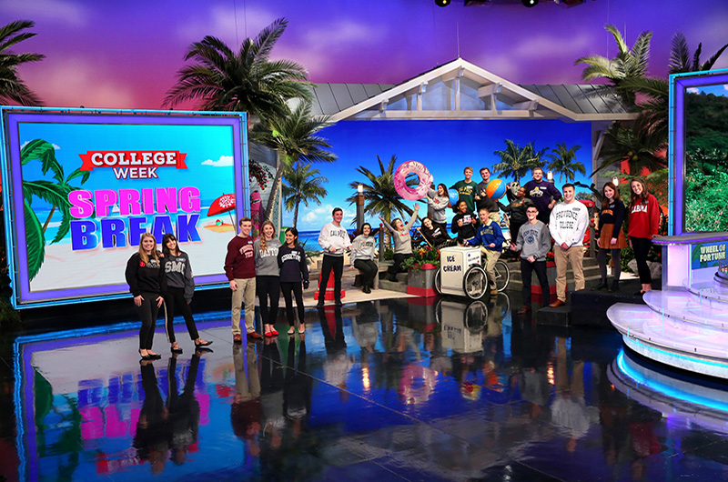 "Drexel University student Zaarah Abdul-Aziz, holding the beach ball on the right, with the other college students who competed on the ""College Week Spring Break"" programming on ""Wheel of Fortune."" Photo Credit: Carol Kaelson."