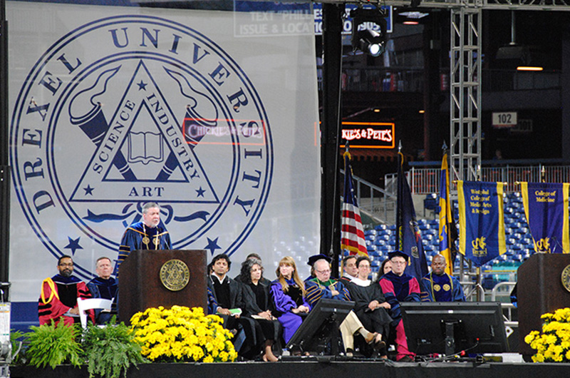 Drexel University President John Fry speaking at the 2018 University-wide commencement ceremony.