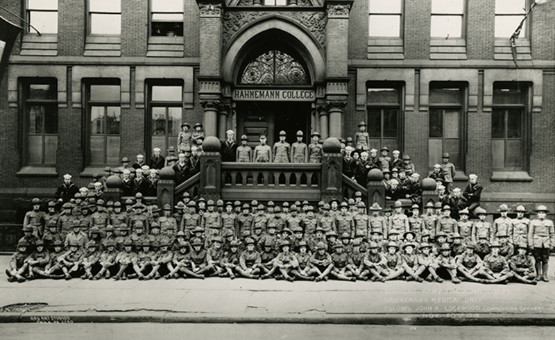 Hahnemann unit of the Student Army Training Corps in 1918, including students still in training at the end of World War I (classes 1919–1922) on the steps of the Broad Street college building. Photo courtesy Legacy Center Archives, Drexel College of Medicine.