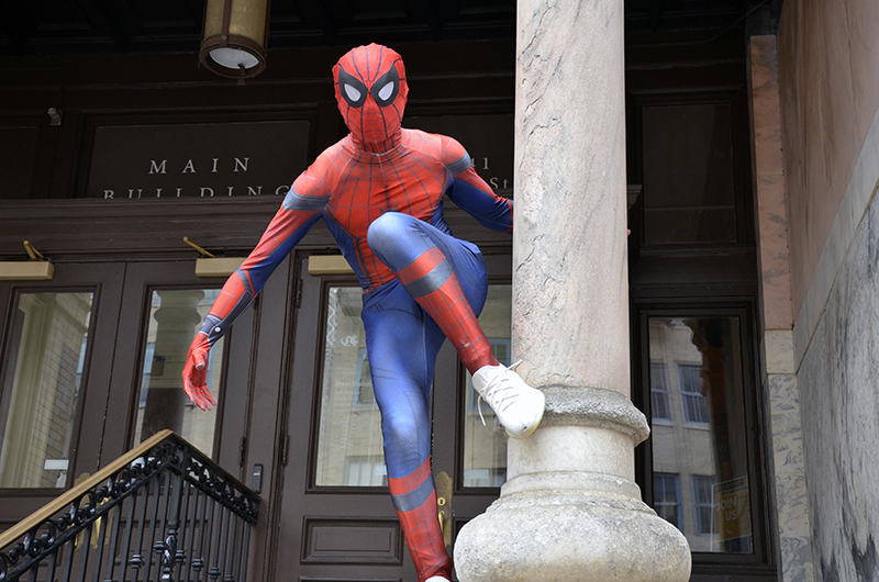 Drexel Spidey poses outside of the Main Building on Drexel's University City Campus.