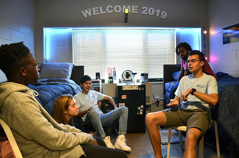 First-year students and resident assistants hang out in a dorm room in Drexel's Bentley Hall.