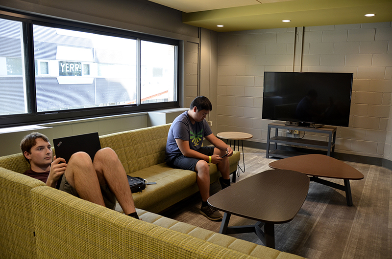 "New residents in Drexel's Bentley Hall enjoying the alternating ""quiet"" and ""social"" lounges that open up from the elevators on each floor."