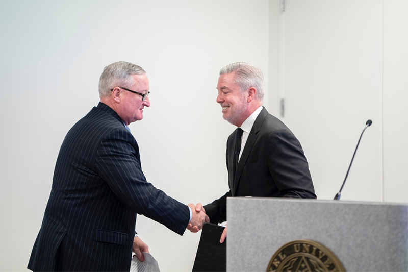 Mayor Jim Kenney shakes hands with President Fry as he is introduced for his speech.