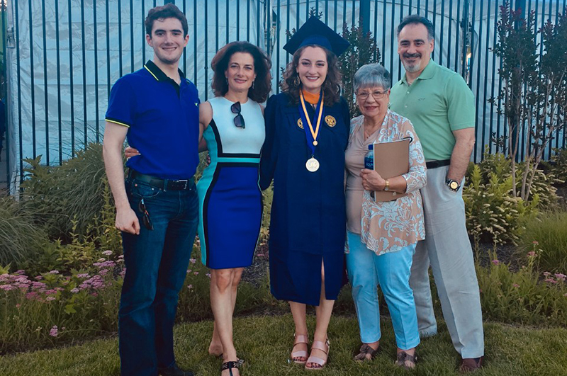Lisa Santore Daughen, chairperson of the Drexel Family Association, with her family at her daughter's graduation from Drexel.