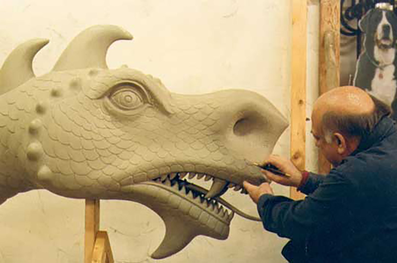 "Eric Berg working on a clay model of Drexel's ""Mario the Magnificent"" statue. Photo courtesy of Eric Berg."