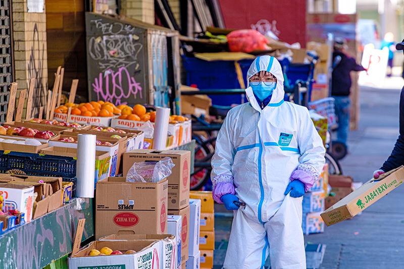 An employee suited up at a Chinatown market.