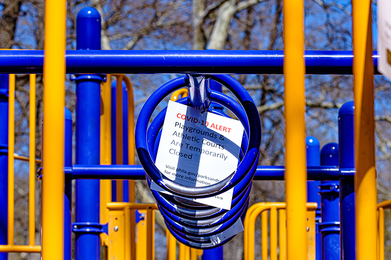 One of the many signs signaling that the playground at Clark Park was closed.