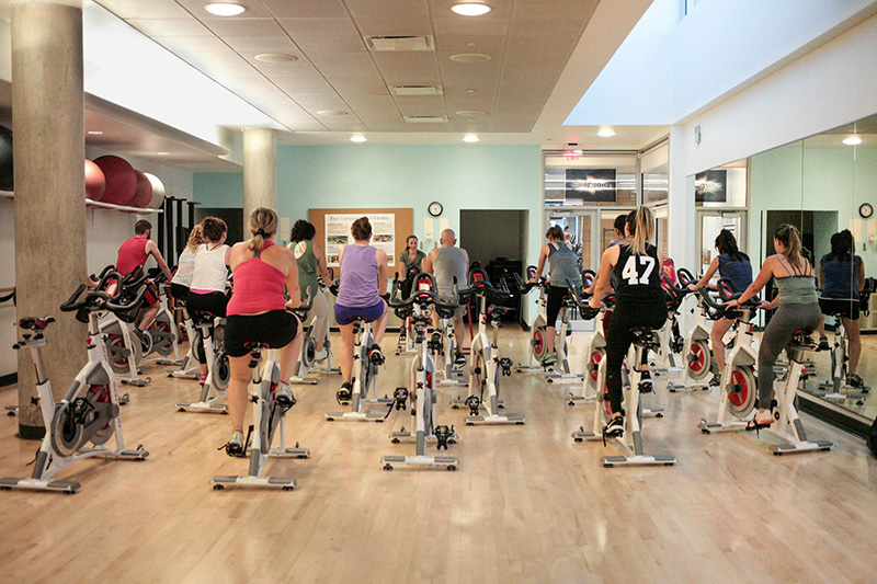 "A ""Cycle 45"" group exercise class held in the Rec Center. The photo was taken in July 2018."