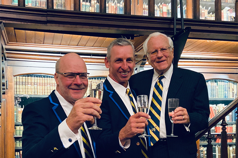 Go Dragons — a toast to 2020! From left: Athletics Director Eric Zillmer, Director of Rowing Paul Savell and Trustee Emeritus and Drexel alumnus George Krall.