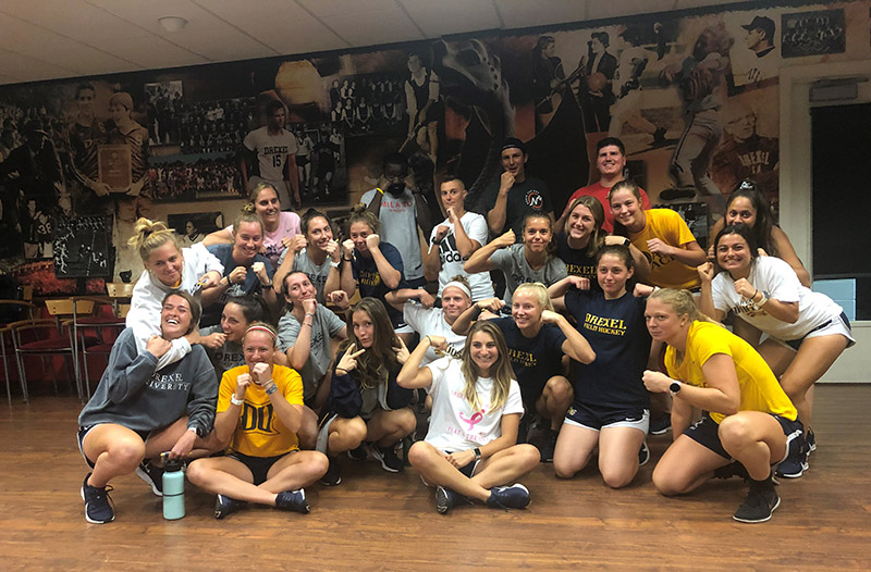 Members of the Drexel Field Hockey team pose with Drexel Police officers after taking the two-hour self-defense class.
