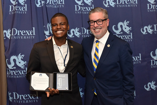"Jabari Jones, left, and Drexel President John Fry in 2016, when Jones was honored for being one of Drexel Magazine's ""40 Under 40"" awardees."