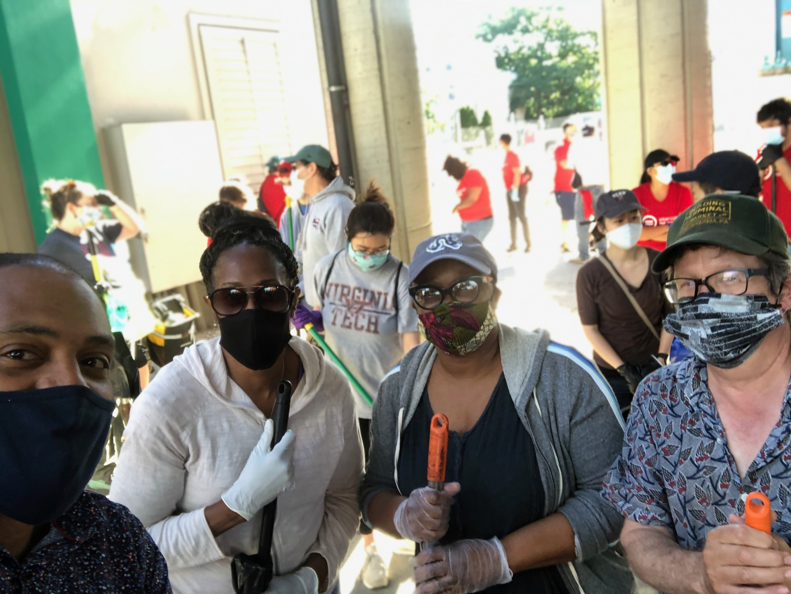 From left to right: Allen Riddick, Una Massenburg, Charlene Rice and Bo Solomon volunteering to clean the area near 52nd and Market streets on June 13.
