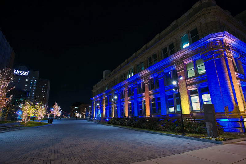 Main Building lit up in blue and gold for Drexel's virtual celebration for the Class of 2020.