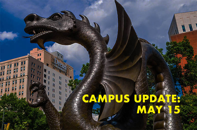 Dragon statue with the words campus update May 15
