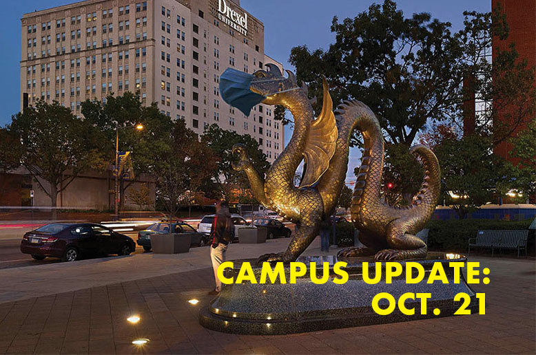 Masked dragon statue with the text, campus update, Oct. 21