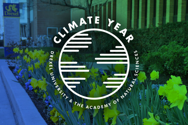 The University's Climate Year logo over a background of flowers on campus.