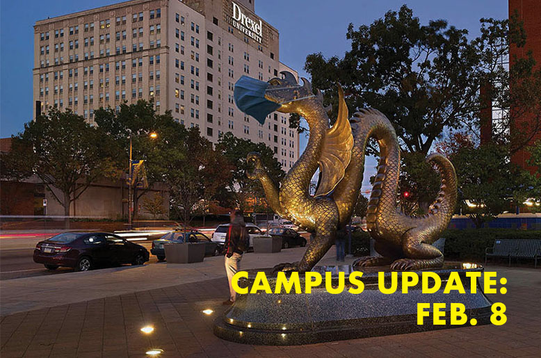 Dragon statue with the text campus updaye Feb. 8