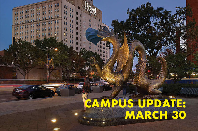 Dragon statue with the text campus update March 30