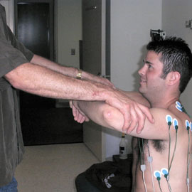 PT researcher testing man's shoulders.