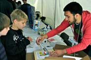 Drexel Student doing an experiment with kids at the Philadelphia Science Festival