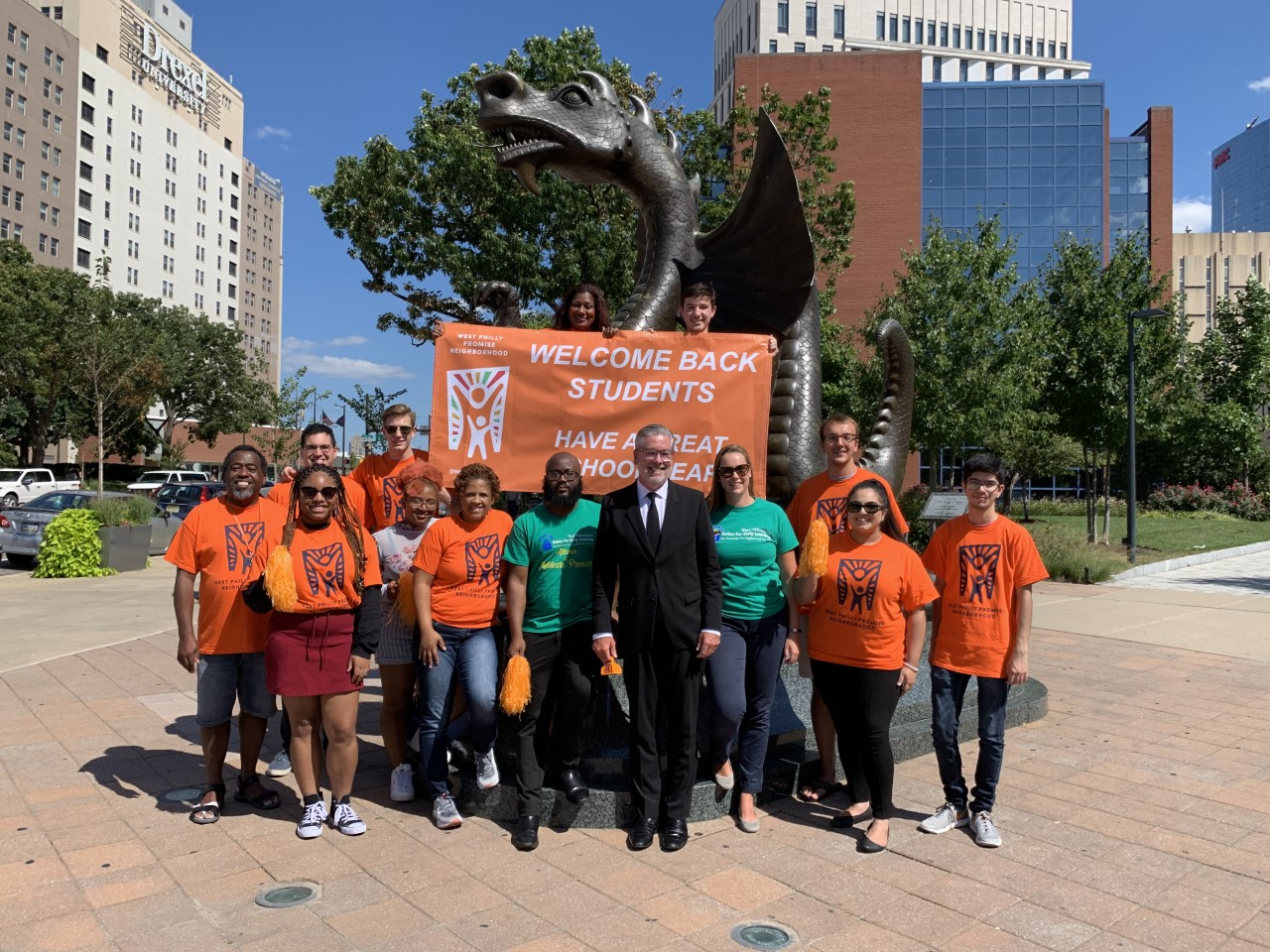 president john fry posing with students