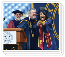 President Fry and a Drexel student taking a selfie at Commencement