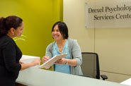 Receptionist with client at Drexel Psychological Services Center