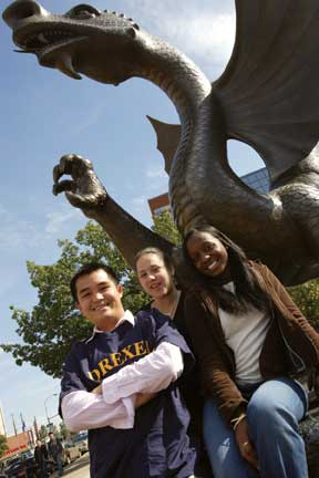 Students posing with Mario the Magnificent statue