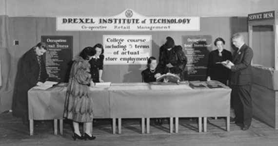 Drexel Institute faculty sharing information about the Co-op program in Retail Management, 1938.