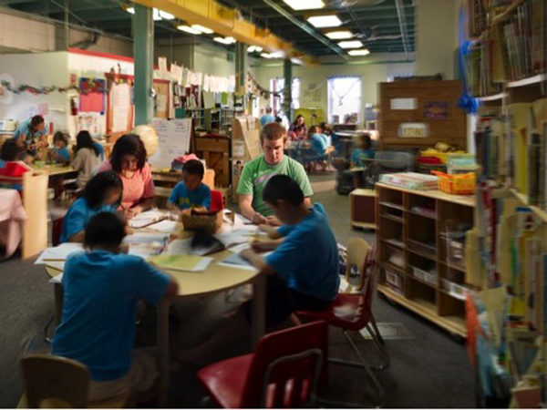 Middle school students working on a project