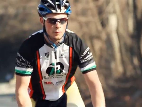 Alumnus athlete on a bicycle