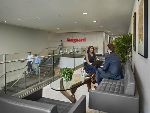 Two employees sitting in lobby area of Vanguard company building