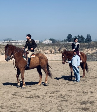 Jeannie D'Agostino riding horses in Pakistan