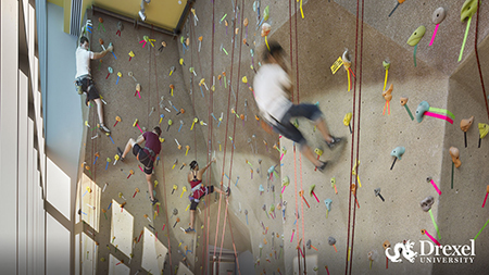 Students climbing at Drexel's rock climbing wall.