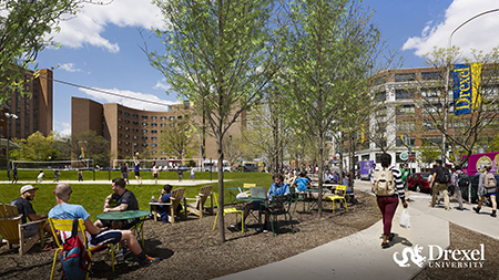 Students study in the sun next to Drexel's outdoor volleyball courts.