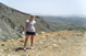<p>Communication major/Aldemar Hotels co-op student Christine Detris overlooking the countryside of Crete</p>