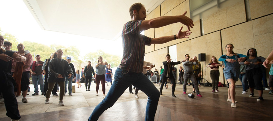 Male performer leading a group of dancers at the Barnes Foundation museum.