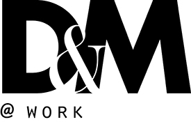 design and merchandising at work logo in black text with white background