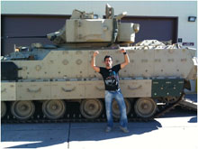 Photograph of Andy Hurwitz in front of a tank
