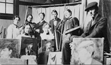 Old Black and White photograph of artists with paintings