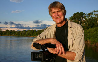 Photograph of Boyd Matson in front of lake and holding a camera