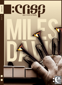 Magazine cover with trumpets, piano and a hand that resembles Mile Davis